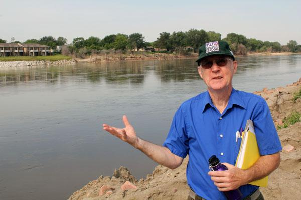 Jim Redmond, with the Northwest Iowa Sierra Club, stands along the Missouri River in Sioux City, Iowa. Redmond said the river could handle the rainfall of the 2011 flood, but not when it's cutoff from the flood plain.