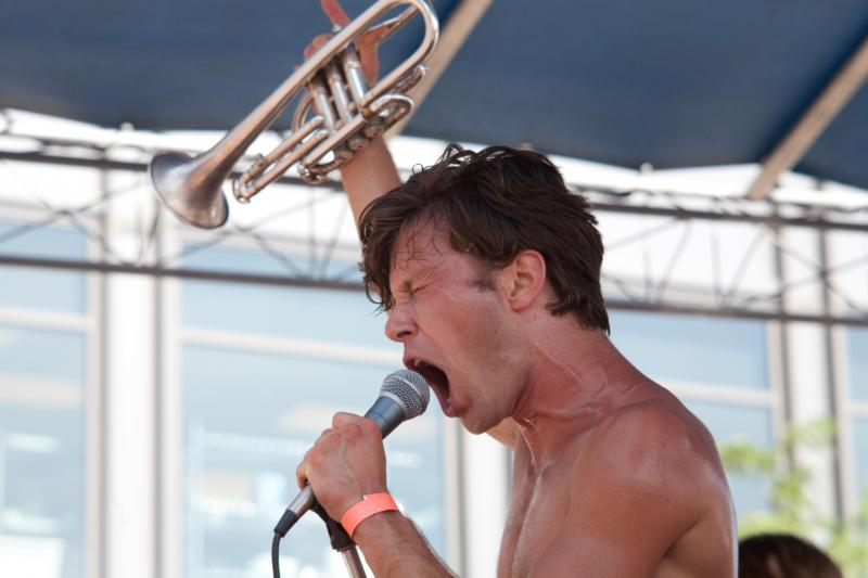 Nate Logsdon singing with the band Mumfords during the 80/35 music festival downtown Des Moines.