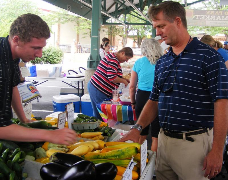 Tom Karst feels right at home on a summer morning at a farmer's market in Overland Park, Kan.
