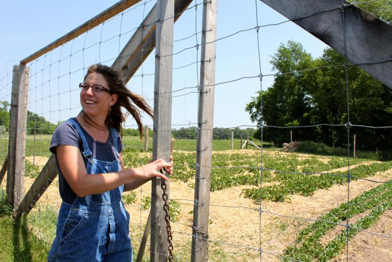 Kate Edwards shows off her small one-acre vegetable plot near Solon, Iowa.