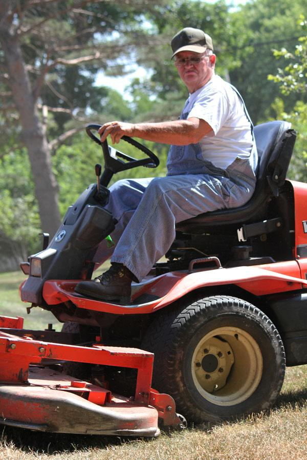 Roger Huggins has owned ADA Mowing since 1979. He says right now his crew is doing weed control.