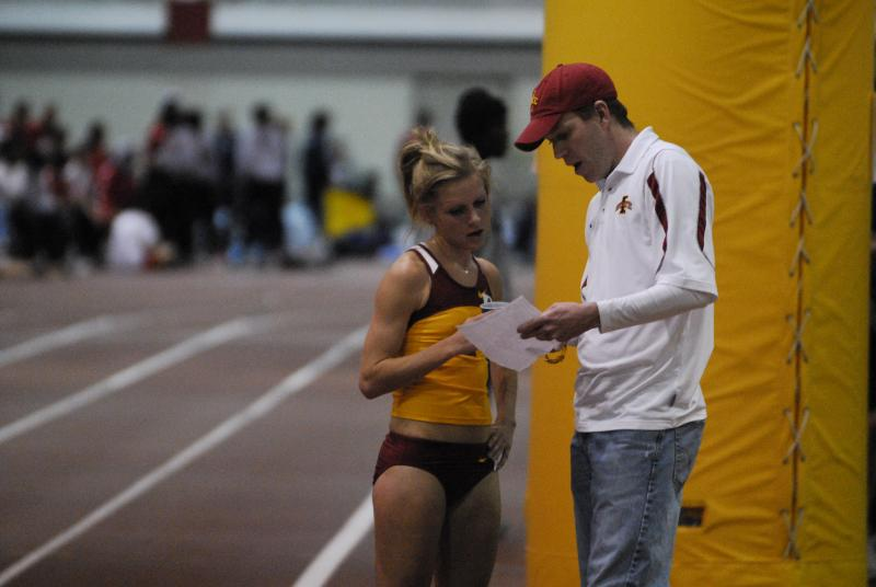 Iowa State University Coach Corey Ihmels talking to runner Lisa Uhl.
