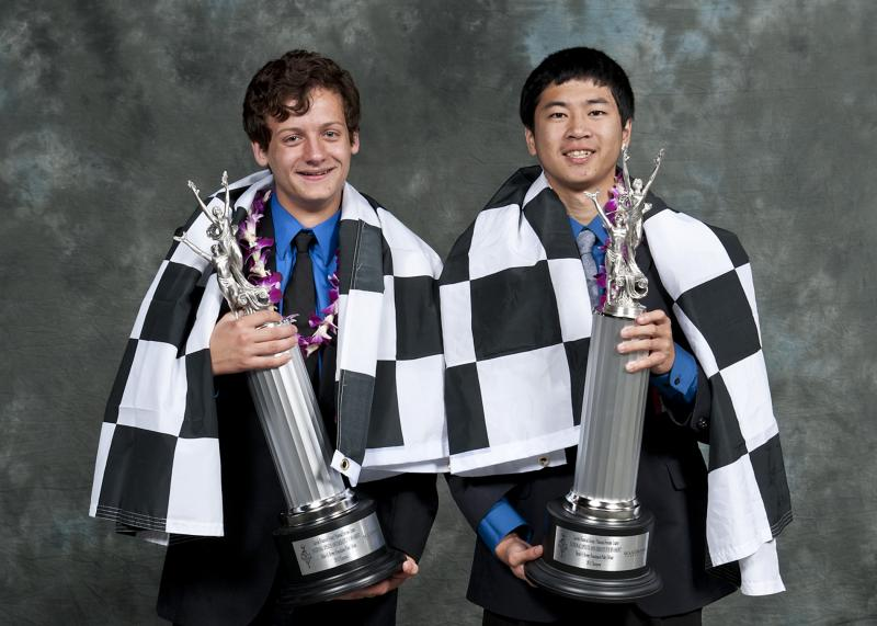 "Champion debaters Liam Hancock and Jeffery Ding pose with the ""Tournament of Champions"" trophies."