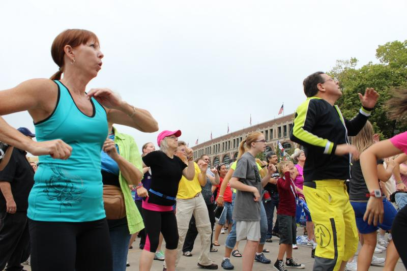 Iowa State Fair attendees participating in the opening ceremony ZUMBA dance.