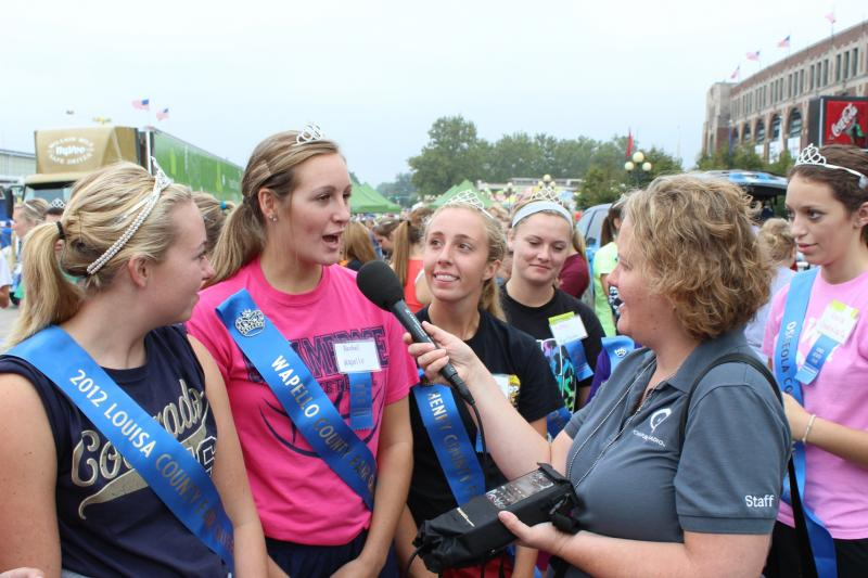 Katherine Perkins interviews county fair queens that participated in the Iowa State Fair opening day ZUMBA dance.