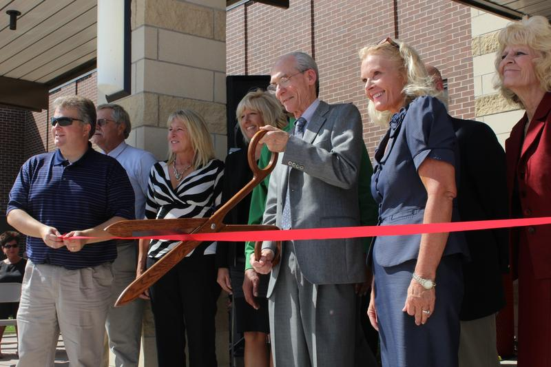 Ed Stone with superintendent Jane Evans cutting the ribbon as Edward Stone Middle School is dedicated.