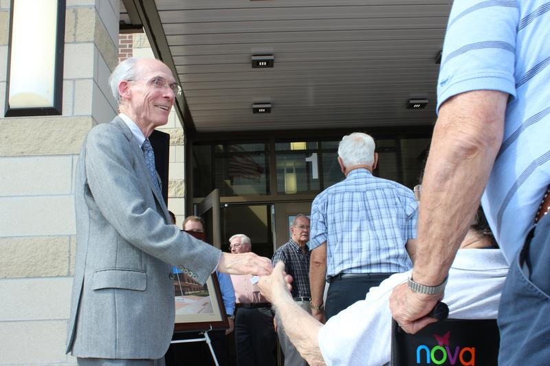 Ed Stone greets his fellow classmates of 1954 members during the Edward Stone Middle School dedication.