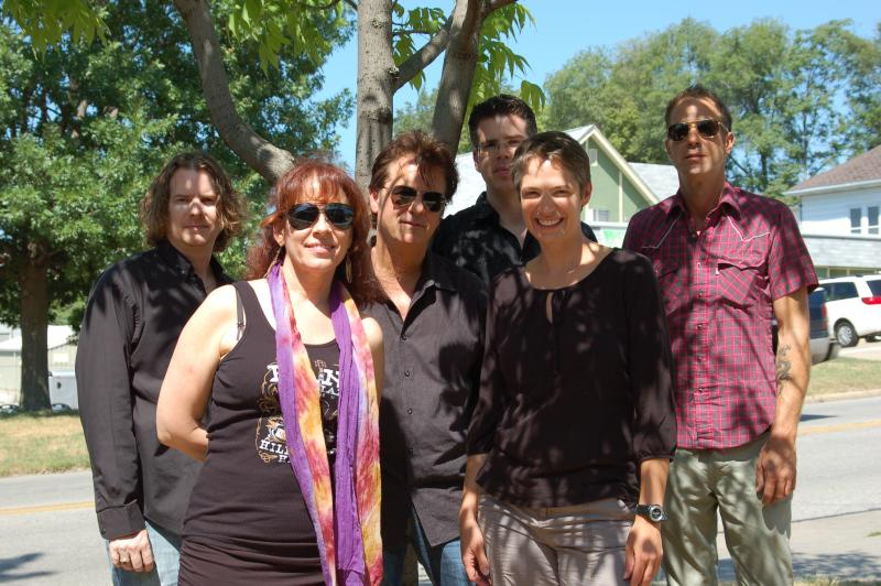 Charity Nebbe with Janiva Magness and her band outside IPR's Iowa City studio