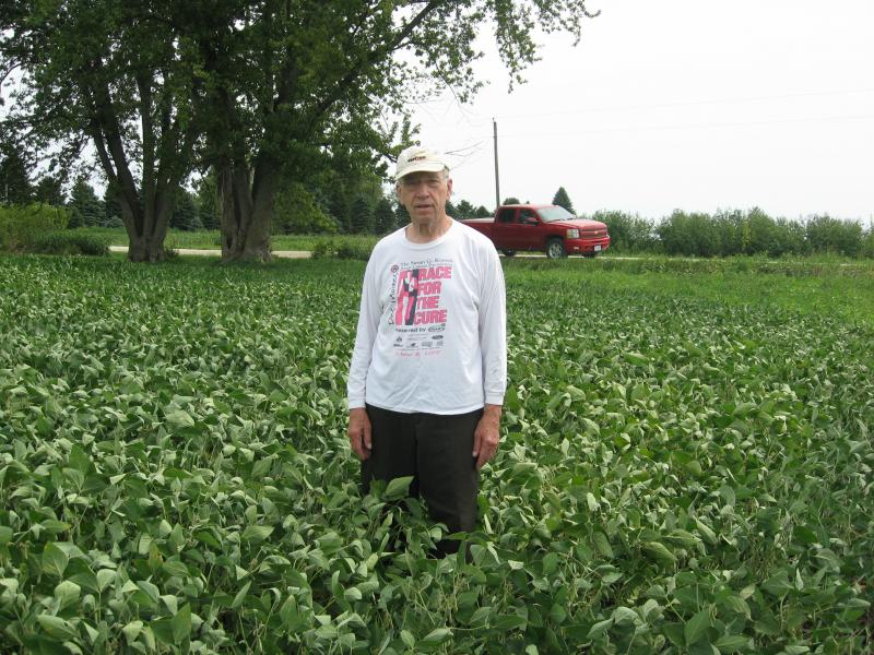 U.S. Senator Chuck Grassley stands in his soybean field near New Hartford, Iowa. In a non drought year, the beans would be waist high.
