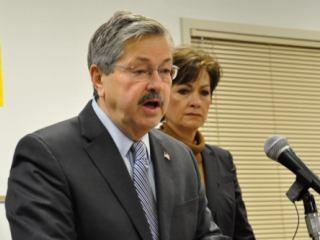 Gov. Terry Branstad (with Lt. Gov. Kim Reynolds, right) is asking state workers to help pay for their health insurance premiums.