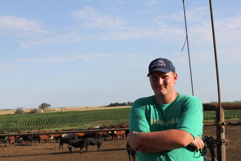 Nathan Dorn stands in front of the feedlot on his family's farm in Adams, Neb.