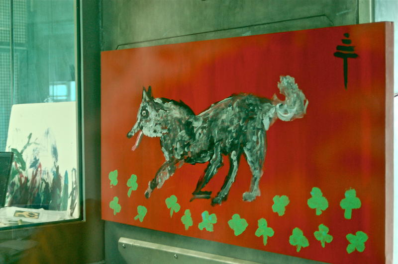 The bonobos at the trust create art themselves, as well as communicating with humans in order to direct the way paintings are made. Here, the dog painting was instructed by a bonobo, while the painting on the left was created solely by Kanzi.