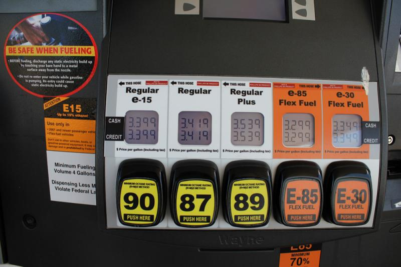 The EPA mandates gas stations display a large orange warning label on every pump that sells E-15. At the Zarco 66 in Lawrence, Kan., E15 is offered among other conventional fuels.