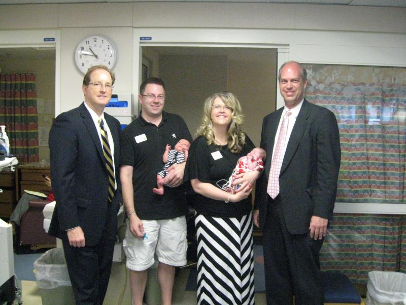 Mayo Clinic pediatric cardiovascular surgeon, Dr. Harold Burkhart, Brad Weitl with Aidan, Christina DeShaw with Ava and Dr. Ben Eidem, pediatric cardiologist