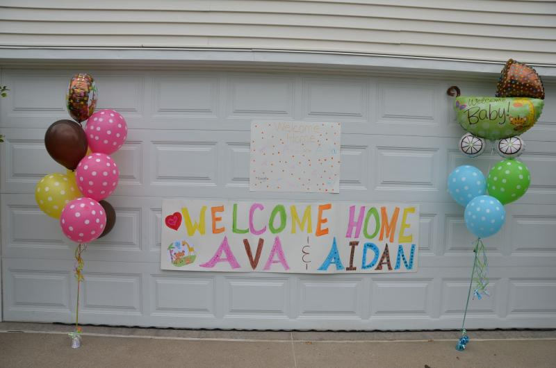 This sign greeted Brad, Christina, Ava and Aidan when they arrived at their home in Clive after Ava spent nearly four months at the Mayo Clinic.