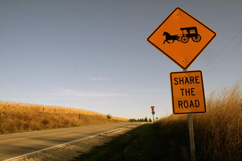 "Members that started the Delhi Amish settlement moved to Delaware County, Iowa last year. Now, signs that read ""Share the Road"" are posted along rural county roads."