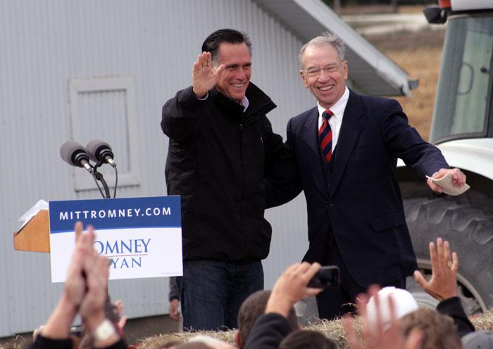 Sen. Chuck Grassley (right) introduced Mitt Romney at his campaign stop in Van Meter, Iowa on Tuesday.
