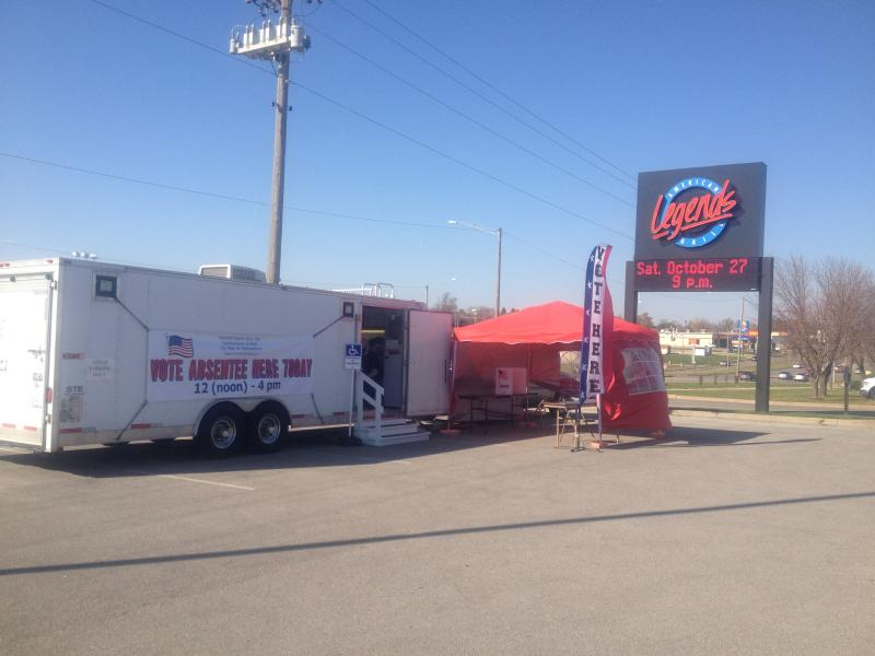The first mobile satellite polling booth in Iowa, outside of a Legends sports bar and grill.