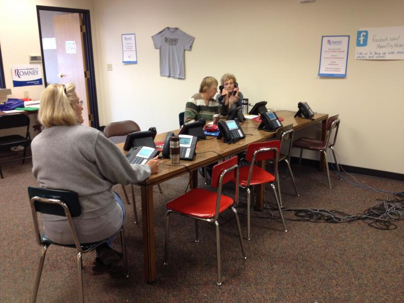 Volunteers make phone calls at the Romney campaign office at a strip mall in Mason City.