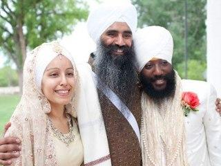 Sikh men wear their hair unshorn with long beards and turbans