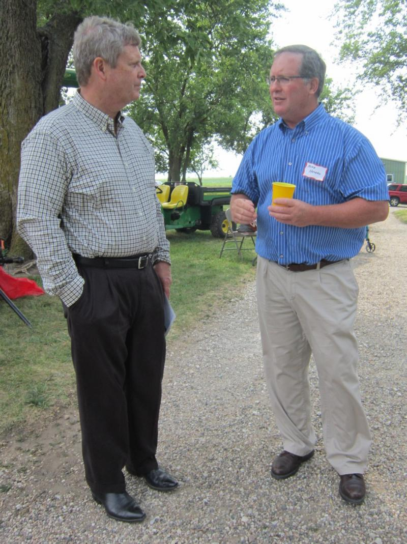 U.S. Secretary of Agriculture Tom Vilsack speaks with Greene County farmer Mike Holden at a campaign event for Vilsack's wife, Christie, the Democratic candidate in the 4th Congressional District.