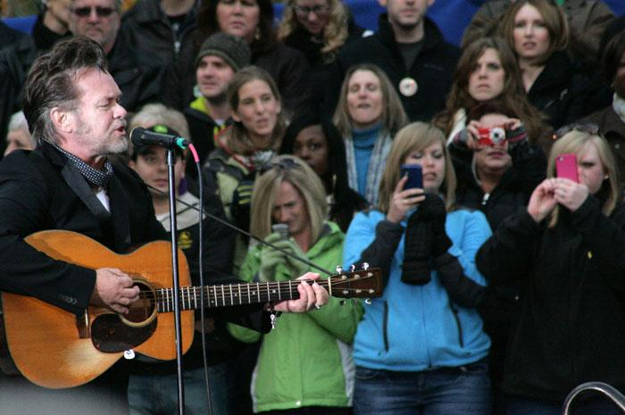 "Singer John Mellencamp performing at the Obama rally in Dubuque. His short set included ""Small Town,"" ""Pink Houses"" and ""Rain on the Scarecrow"""