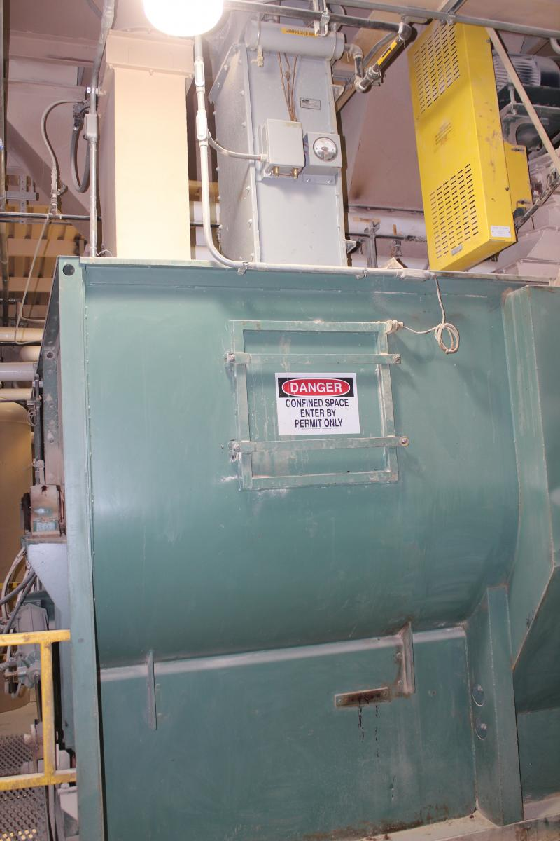 First the dry ingredients are blended in this six-ton mixer. Then the wet ingredients are added via overhead pipes.