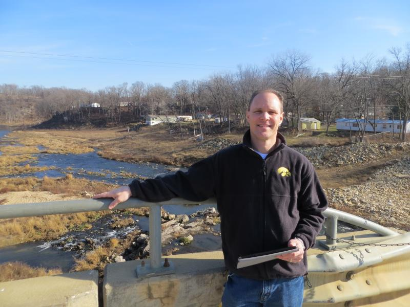 Steve Leonard on Lake Delhi's dam, the Maquoketa River flowing by.