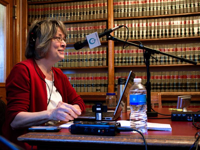 Iowa Public Radio's statehouse bureau chief Joyce Russell in the law library providing analysis of Governor Branstad's Condition of the State.