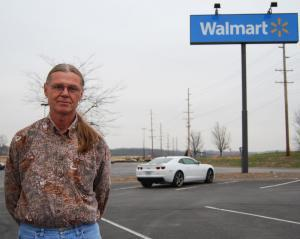 Produce broker Herman Farris stands in the parking lot of the east-side Wal-Mart in Columbia, Mo., before heading to St. Louis to pick up a shipment of bananas for Wal-Mart.