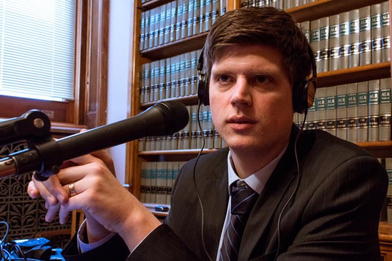Iowa Public Radio statehouse correspondent Clay Masters hosts the talk show River to River from the Capitol's law library.