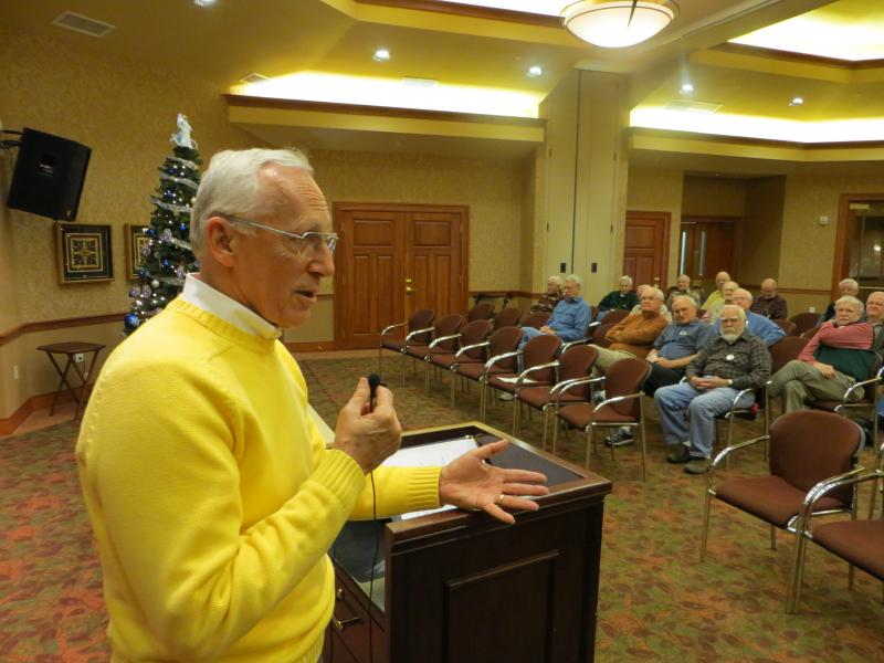 Former Navy radar intercept officer Larry Spencer shares his experiences as a POW to a mens' club at the Edgewater Community.