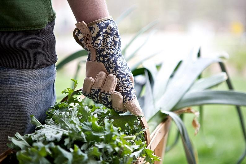 A gardener carries vegetables.