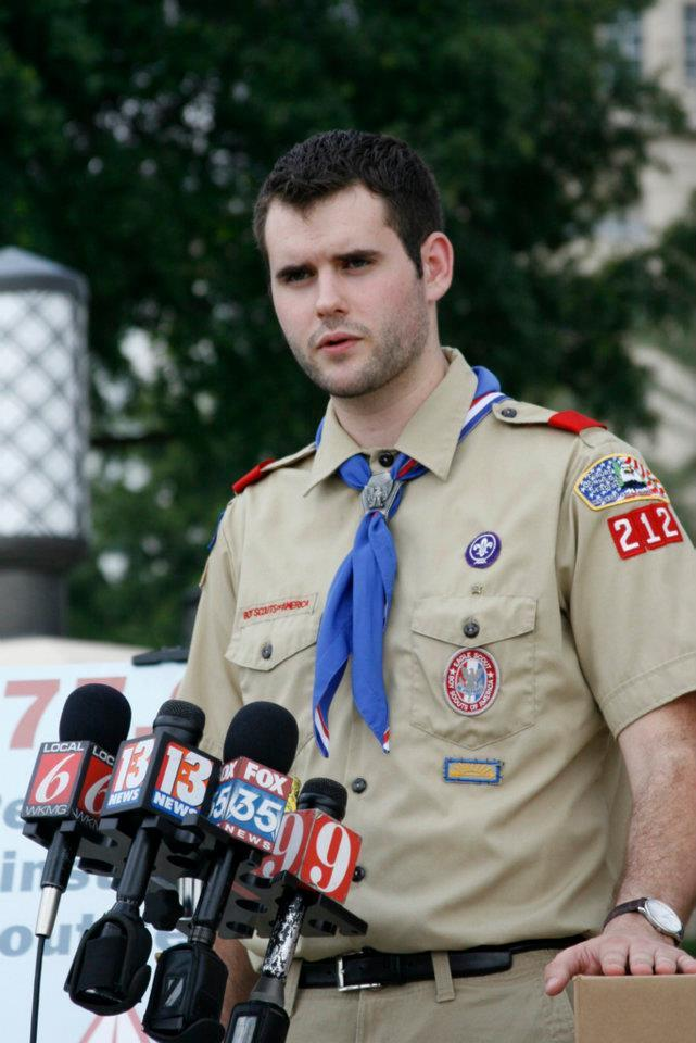 Zach Wahls in his BSA uniform, speaking to reporters.