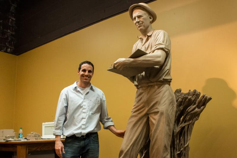 Benjamin Victor stands next to his clay sculpture of Norman Borlaug at the Iowa Historical Building.  Soon it will be cast in bronze and in 2014 installed in the United States Capitol as part of the National Statuary Hall collection.