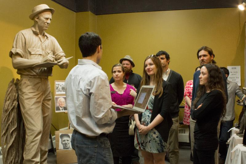 With his sculpture of Norman Borlaug nearly complete, Benjamin Victor answers questions from visitors at the Iowa Historical Building.