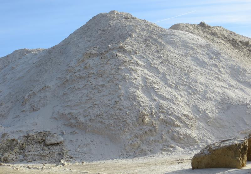 A pile of recently-mined sand sits on the ground at Pattison Sand Company in Clayton County, Iowa.