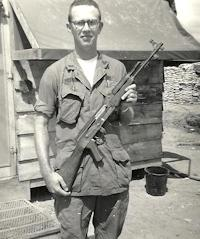 Lt. Robert McKnight at Dak To, holding an enemy AK-47 assault rifle, 1968.