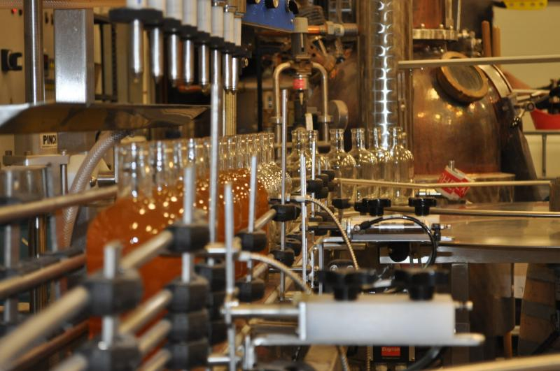 Single-malt whiskey moves down the production line at a micro-distillery in Swisher, IA