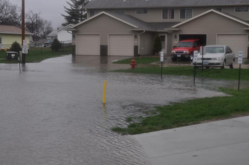 Flash floods in the Apple Valley subdivision in Solon, Iowa around 2 p.m. April 17.  Neighbors stacked sand bags around basement windows and along garage doors.