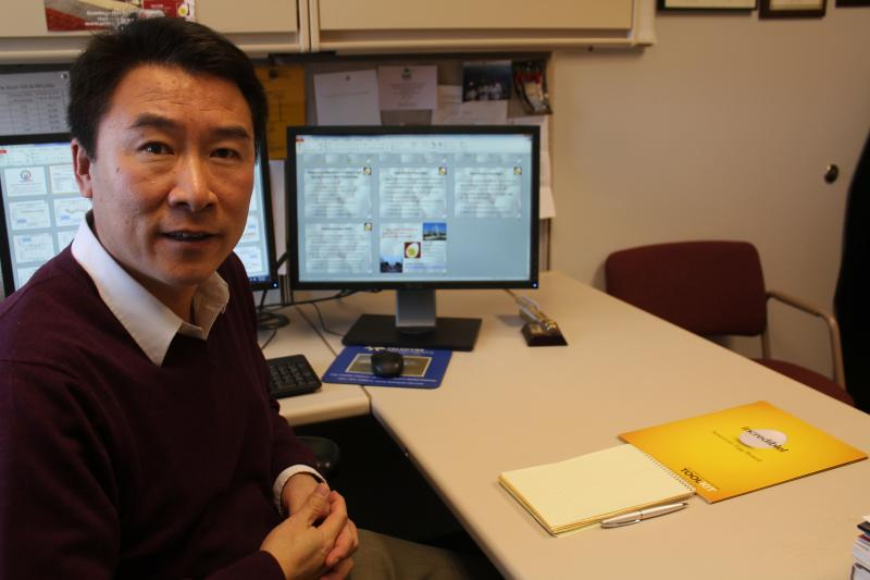 Iowa State University professor and Egg Industry Center director Hongwei Xin works on a Power Point presentation. He's sharing results of his study on the environmental impact of the egg industry.