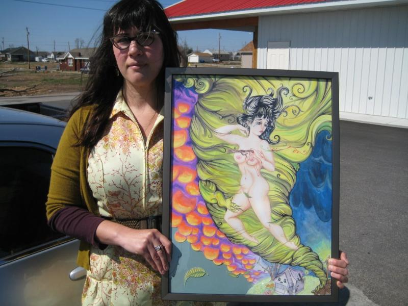 Joplin tornado survivor and artist Martha Goldman with her interpretation of the disaster. The only part of her house left standing was the closet where she and her husband sought shelter.