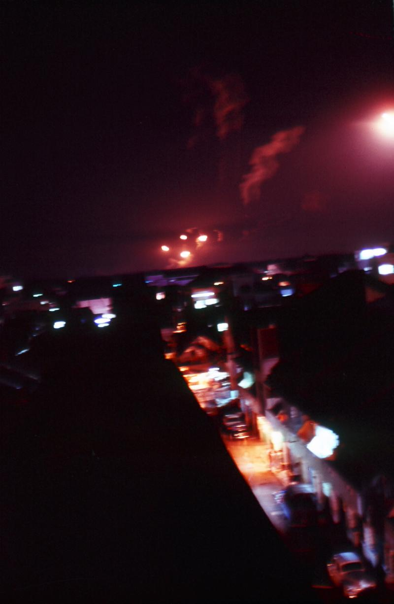 Flares light up the night on the outskirts of Saigon, 1969.