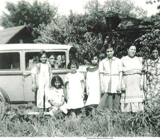 Family posed in front of car, Holy City, Bettendorf, Iowa, 1920s