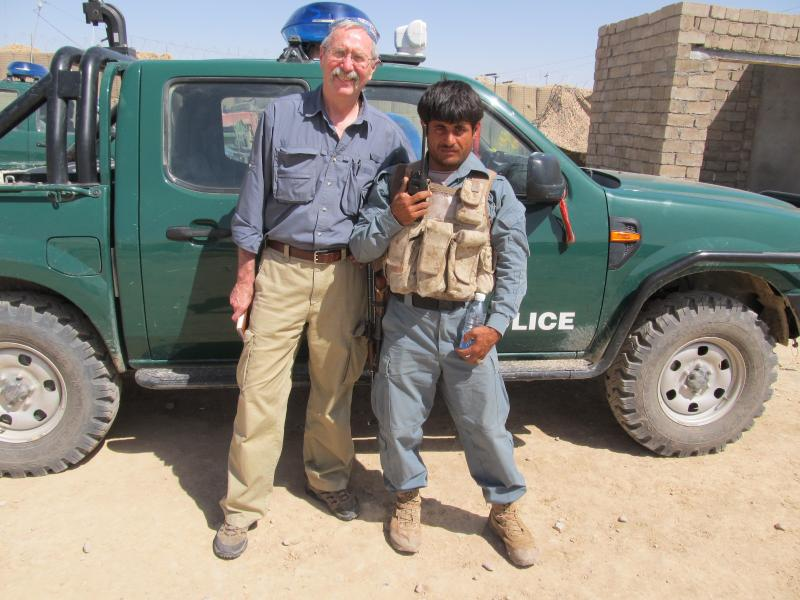 Journalist Peter Eichstaedt with his police escort in Marja, Helmand Province, a province in southern Afghanistan, in April 2011.