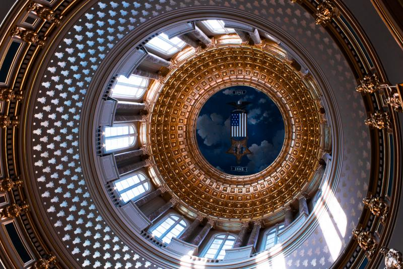 The light of the sun beams through the windows of Iowa's Capitol dome.