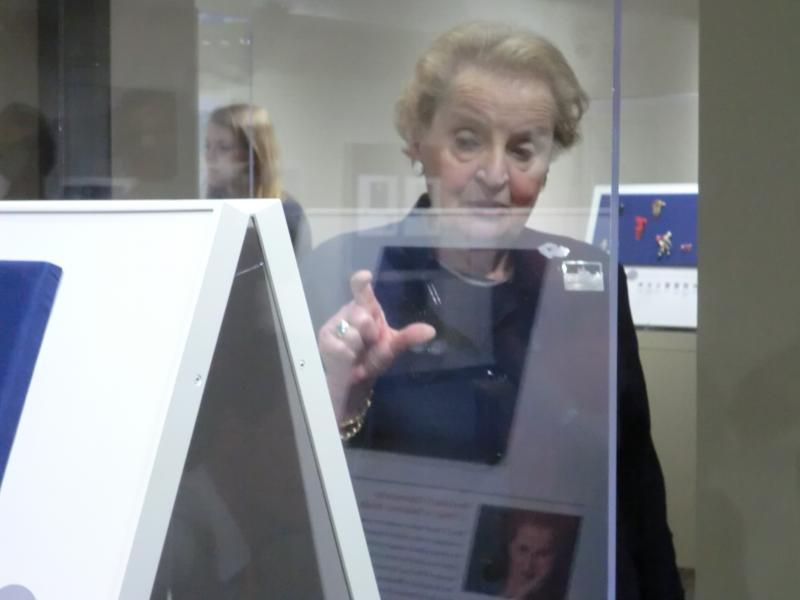 Madeleine Albright walks through an exhibit of her pins at the National Czech and Slovak Museum in Cedar Rapids.