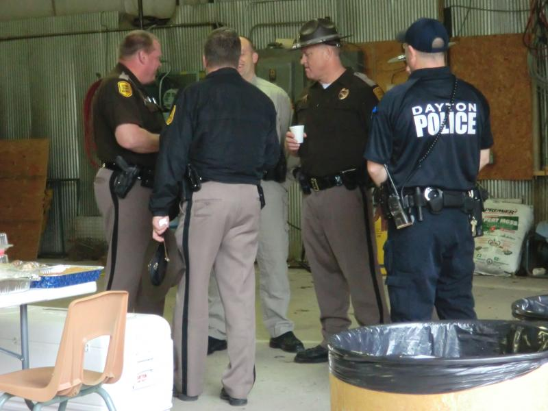 State troopers meet to coordinate the search for Kathlynn Shepard on Wednesday morning.