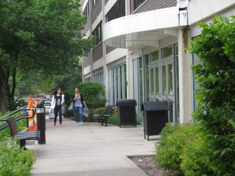 Two students walk up to Mayflower Residence Hall Tuesday evening.