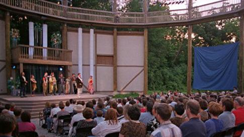 A crowd watches a performance during the Shakespeare festival at the Riverside Theatre in Iowa City in June 2001.